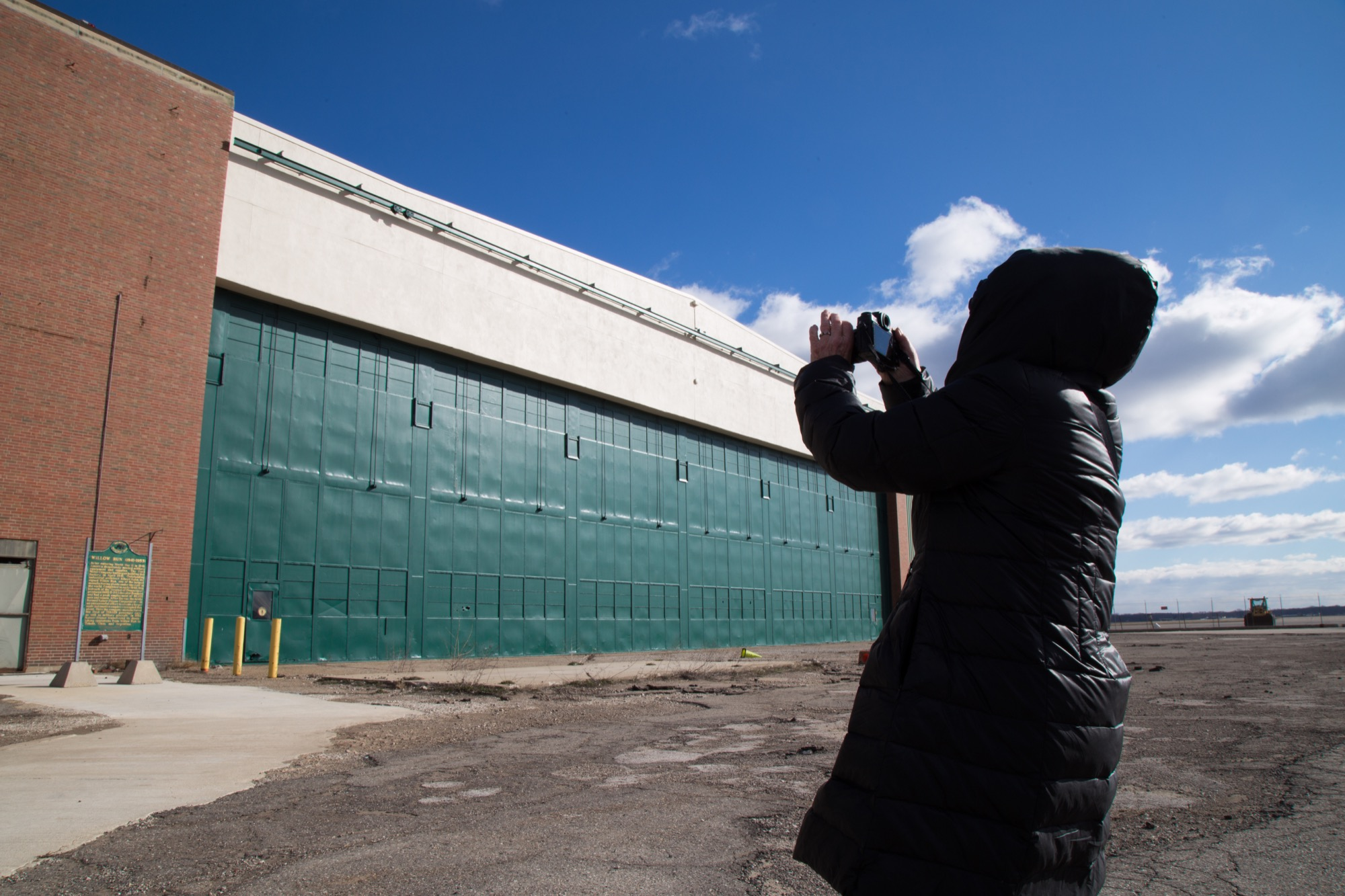 Ruben photographs the exterior of Willow Run.