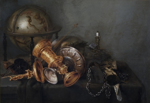 This remarkable still life depicts a table crowded with, among other things, a gilded covered goblet, a wide saucer-shaped silver tazza, a celestial globe painted with images of the constellations, a skull wearing a laurel wreath, and an extinguished candle, all rendered in exquisite detail with careful attention paid to the effects of light and texture. While the arrangement of objects may appear casual, the composition is artfully balanced along two diagonal axes centered on the two cups that lie crossed