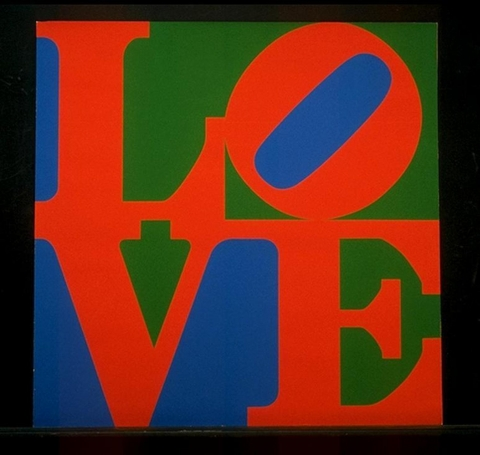 """The word """"love"""" printed in capital letters in red on a blue and green background with a black border or frame"""
